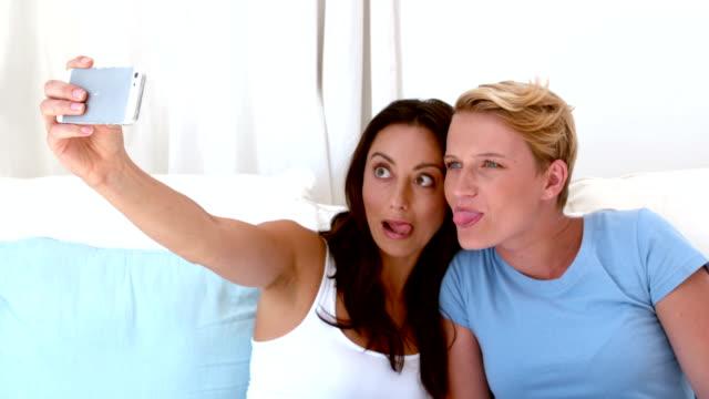 Lesbian couple taking a selfie video