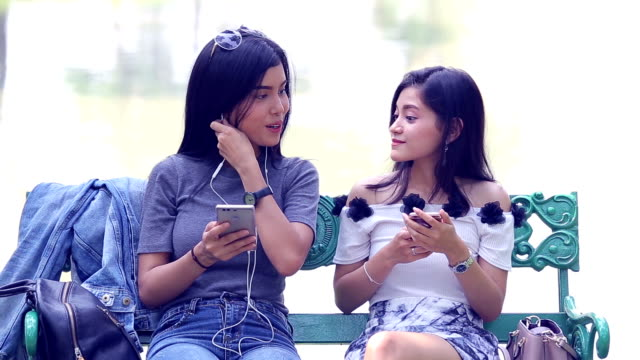 Lesbian couple using smartphone video