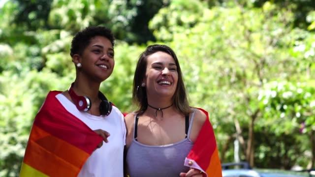 Lesbian Couple with Rainbow Flag