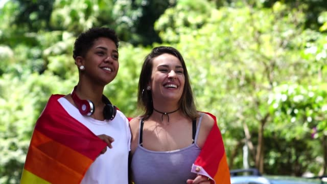 Lesbian Couple with Rainbow Flag Weekend Activities pride stock videos & royalty-free footage