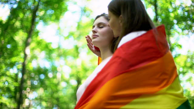 Lesbians kissing, concept of minority rights and public declare of same-sex love video