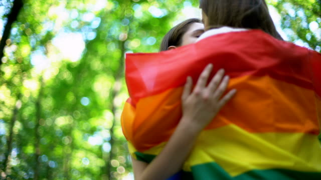 Lesbians kissing gently, minority rights protection, public declare of equality video
