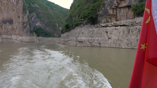 Lesser three gorges view from a boat with waving Chinese flag