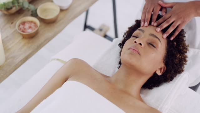 Let the healing begin 4k video footage of a young woman getting a massage at a spa face mask videos stock videos & royalty-free footage