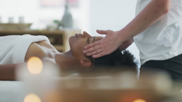 Let us take care of you 4k video footage of a young woman getting a head massage at a spa beautician stock videos & royalty-free footage