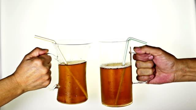 """vídeos de stock, filmes e b-roll de vamos comemorar, câmera lenta """" - tea drinks"""