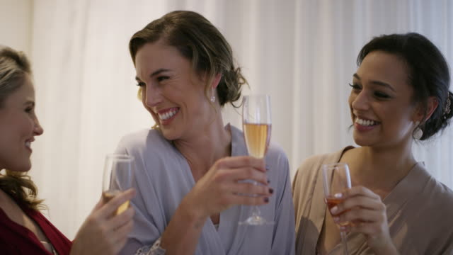 Let's raise our glasses, our girl's getting married