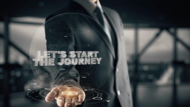 vídeos y material grabado en eventos de stock de vamos a empezar el viaje con el concepto de empresario de holograma - entrenador