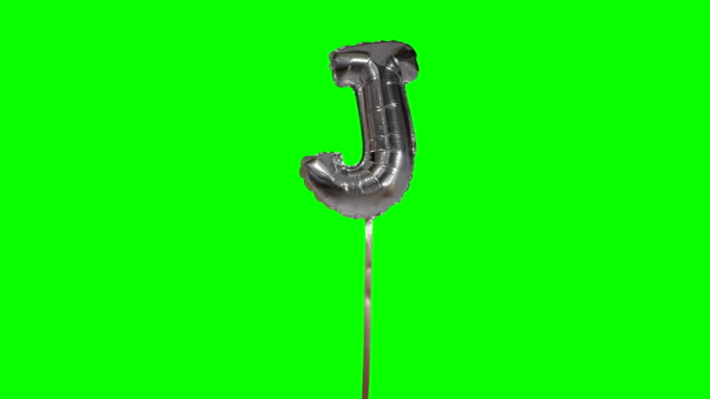 Letter J from alphabet helium silver balloon floating on green screen