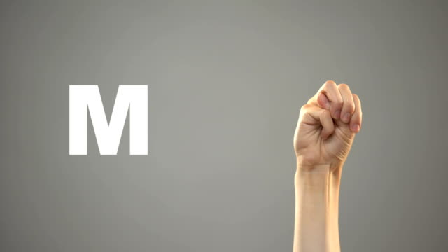 Letter M in sign language, hand on background, communication for deaf, lesson