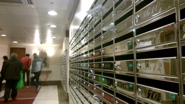 Letter mailing box and residents at a building lobby video