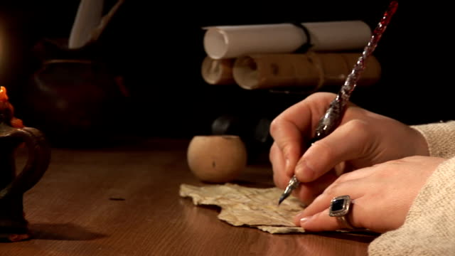 Letter Close-up of a hand as it writes a letter on a paper. renaissance architecture stock videos & royalty-free footage