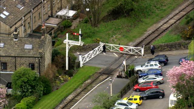 level crossing gates opening - Aerial View - England,  Bradford,  United Kingdom video