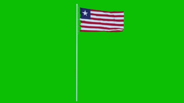 liberia flag waving on wind on green screen or chroma key background. 4k animation - liberia video stock e b–roll