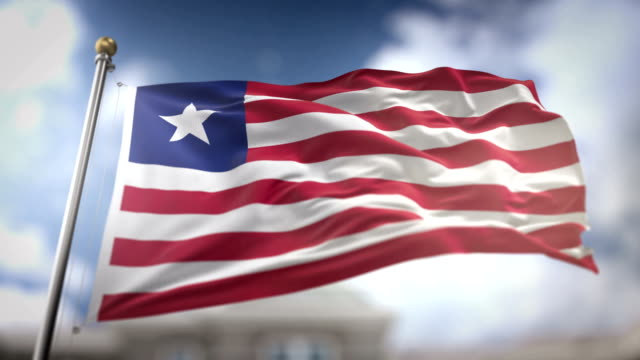 liberia flag waving slow motion 3d rendering blue sky background - seamless loop 4k - liberia video stock e b–roll