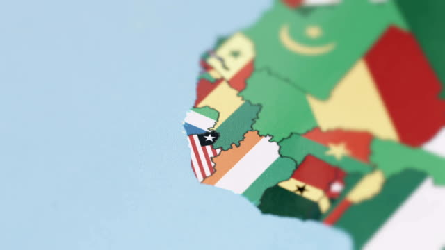 liberia, sierra leone borders with national flag on world map - liberia video stock e b–roll