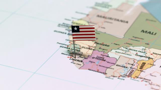 liberia with national flag - континент географический объект стоковые видео и кадры b-roll