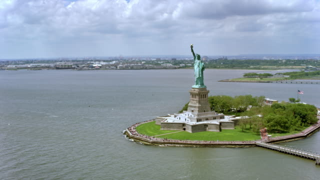AERIAL Liberty Island and the Statue of Liberty in sunshine