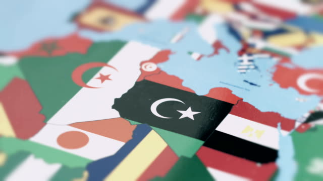 libya borders with national flag on world map - libia video stock e b–roll