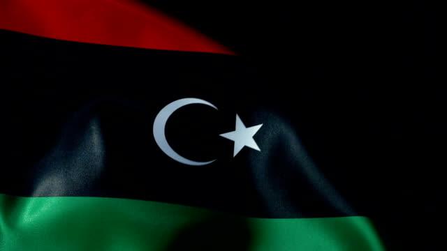 libya flag flapping - линия экватора стоковые видео и кадры b-roll