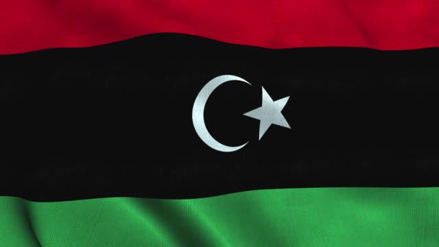 bandiera libica che sventola nel vento. stato di bandiera nazionale della libia - libia video stock e b–roll
