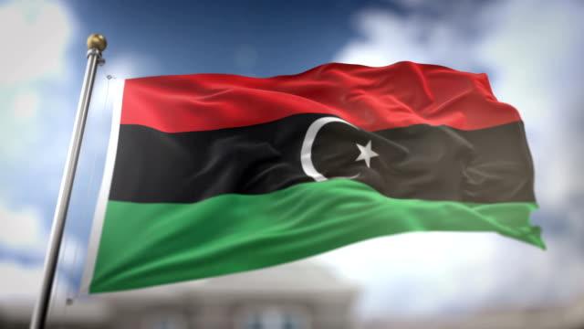 libya flag waving slow motion 3d rendering blue sky background - seamless loop 4k - libia video stock e b–roll