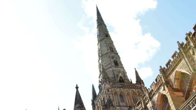 lichfield cathedral stands grand and gothic against the blue sky - gargoyle video stock e b–roll