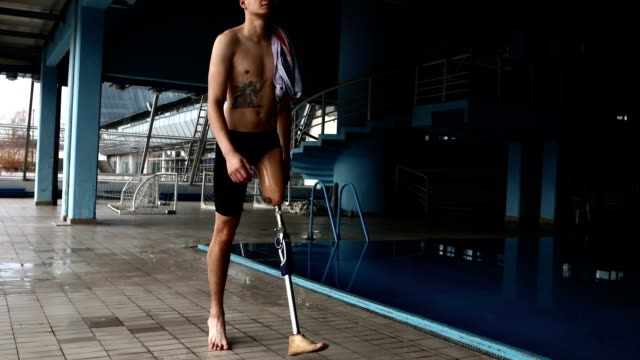 Life goes on Man with disability at swimming pool amputee stock videos & royalty-free footage