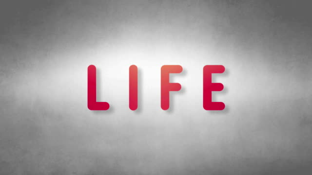 Life headband. Text from sand. With black background video