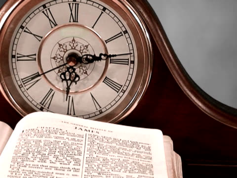 Life is a Vapor Clock ticking with Bible open to book of James, fog in background. religious text stock videos & royalty-free footage