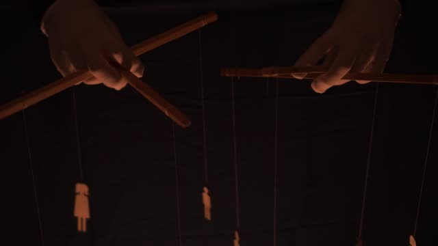 Life is marionette theatre concept. Marionette control bar with strings