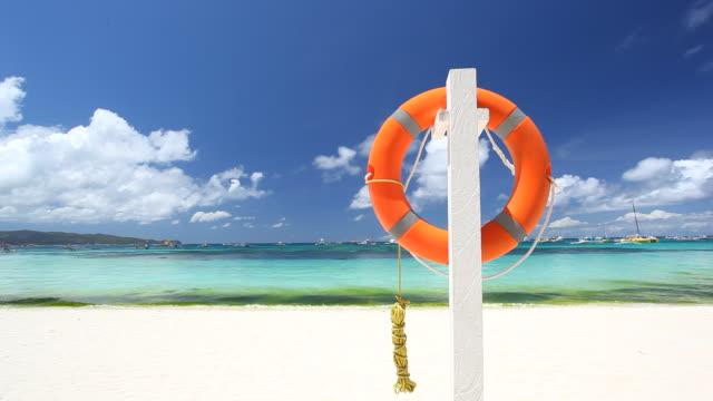 Lifebuoy ring on tropical beach video