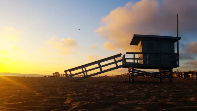 Lifeguard hut and pier  at sunset in manhattan Beach video