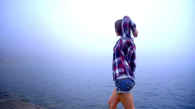 lifestyle woman having fun walking sea. lifestyle concept - pantaloncini video stock e b–roll