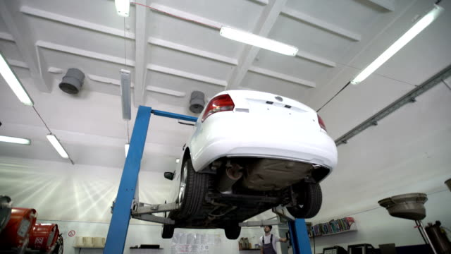 Lifting cars in car repair shop video