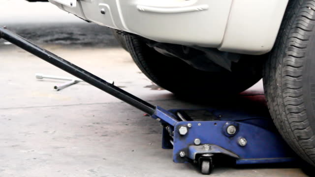 Lifting jack Auto mechanic suspension was reduced to jack repaired. crank mechanism stock videos & royalty-free footage