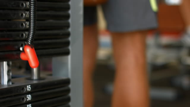 Lifting the heavy weights in the gym. video