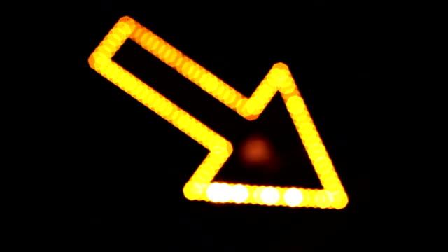Light arrow, directional sign, light reflection, city lights. video