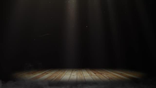 stockvideo's en b-roll-footage met lichtschermbewaking cat.2 op het lege podium met concert spot verlichting over de donkere achtergrond en houten vloer - toneel