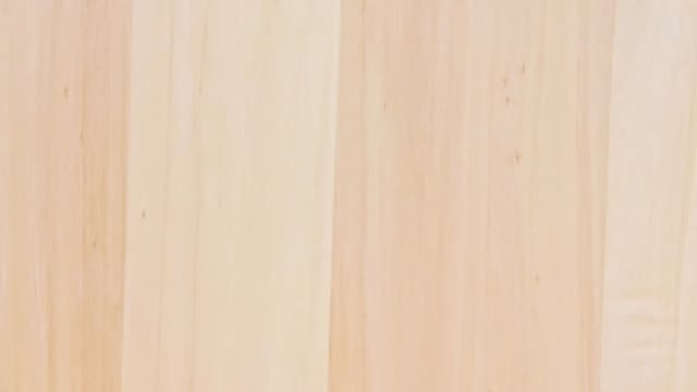 Light brown wooden surface texture rotation background