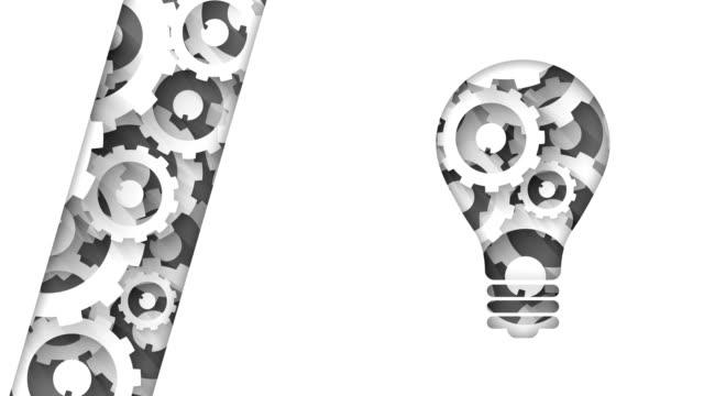 vidéos et rushes de ampoule d'éclairage industriel abstrait avec roues dentées - rouage mécanisme