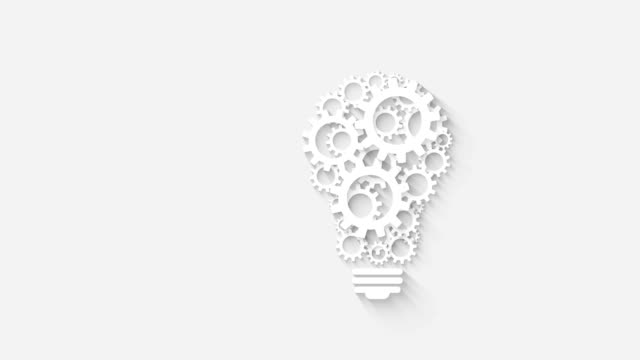 light bulb design by rotating cogs and gears on gray background