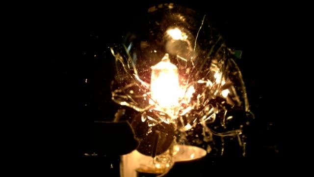 Light bulb exploding on black background video
