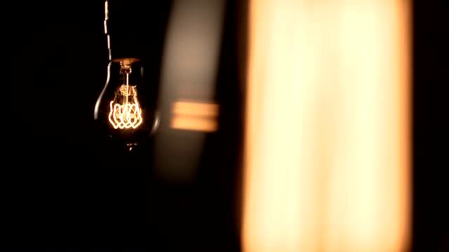 Light bulb hanging and swinging video