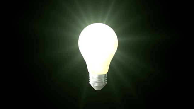 Light bulb on black background video