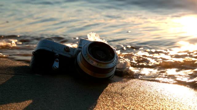 Light bulb on the sand beach Light bulb on the sand beach FullHD lamp shade stock videos & royalty-free footage