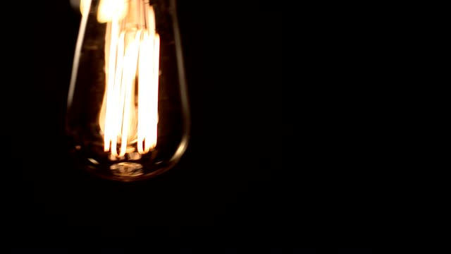 Light bulb swinging in foreground video