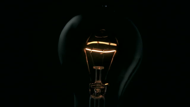 light bulb turning on - idea stock videos & royalty-free footage