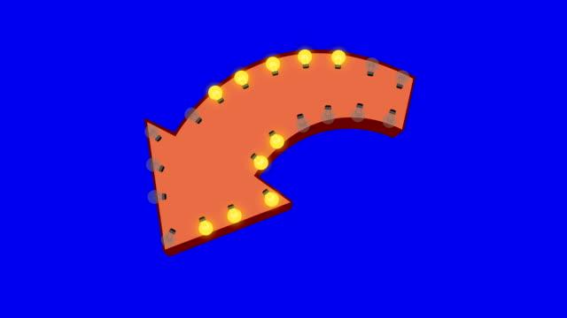 light bulbs billboard sign in arrow shape on a blue screen background - arrow filmów i materiałów b-roll