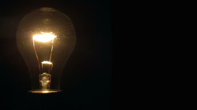 HD Light bulbs illuminate a dark room.​ video